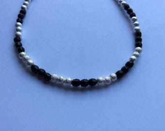 Black and silver bead bracelet with a Tibetan silver charm