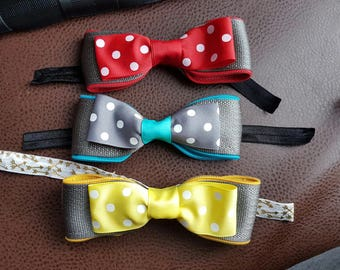 Seatbelt webbing and grosgrain ribbon bow with zipper detail and elastic ties