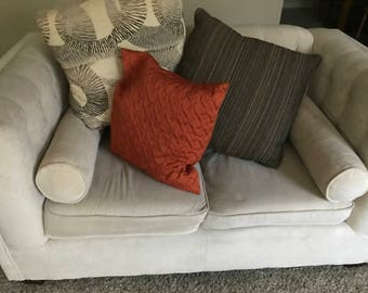 Cream couches with decorative pillows