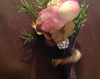 Non-traditional, pink/mauve pin on corsage