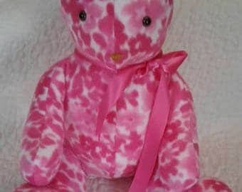 Plush pink stuffed bear.  Irresistible!