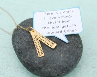 "Leonard Cohen Hand stamped quote necklace, ""There's a crack in everything.  It's how the light gets in""  GOLD VERMEIL  Chocolate and Steel."