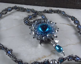 beadweaving necklace blue rivioli crystal with silver star and turquoise pendant stars