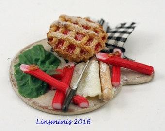 12th scale handmade miniature Making Rhubarb Pie.