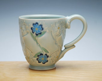 Blue Flowers stamped mug in Frost w. colorized detail, Victorian modern