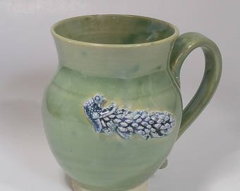 Green 20 oz Pottery Mug with Blue Speckled Peacock Applique - Wheel Thrown and Altered Pottery - Made by Jolene