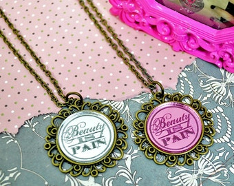 Engraved BEAUTY IS PAIN - Round Cameo Silver or Pink Glass Bronze Cabochon Necklace