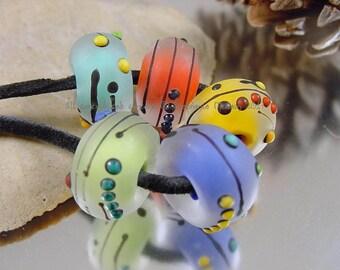 Handmade lampwork glass bead set, Artisan glass beads, yellow beads, blue beads, green beads, red beads, etched beads, SRA lampwork beads