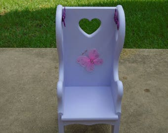 Child's upcycled wood doll chair with high back in pastel lavendar purple with heart cutouts and butterfly embellishmants