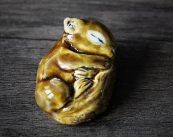 Baby squirrel - Little precious sleepy squirrel - hand made porcelain ceramic art by Fanny Dallaire