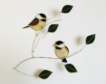 Chickadee pair stained glass suncatcher , birds on a 3 dimentional wire branch adorned with green glass leaves.