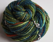 Handspun Art Yarn - SNAKE VENOM - Colorful, Bright, Soft Yarn. Orange, Green, Teal, Snake Charms, Sparkly Glass Beads. Unique Luxury Yarn.