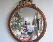 Vintage round wooden mirror with gold trim