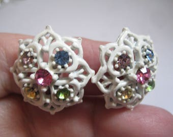 White Enamel Flower Shaped Clip on Earrings with Multi Colored Rhinestones