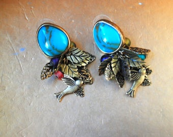 Boho vintage 90s , large faux turquise, pierced earrings with a dangle, gold tone metal filigree leaves, beads and bird between.