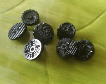 Vintage Buttons - lot of 7 assorted small sized pressed designs Victorian jet black glass,(mar 52 17)