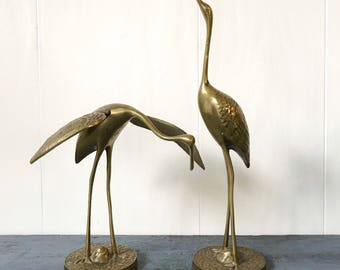 vintage brass crane sculptures - gold metal bird statues - Asian Chinoiserie - Hollywood Regency