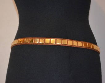Vintage belt by Ruza.  Skinny leather with gold tone studs. Studded skinny belt. Deadstock 27 through 32