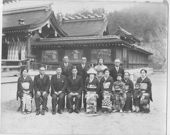 Vintage Japan photo  a black and white photo of a group of Japanese men and women in front of a building