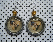 Hufflepuff house crest Hogwarts Hufflepuff Harry Potter inspired bottle cap earrings with yellow gold glass beads