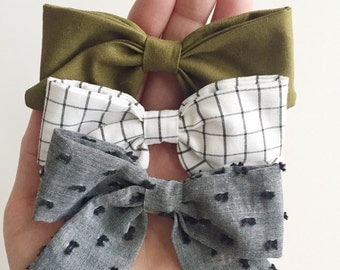 Hand tied fabric bow on Nylon Elastic headband or Alligator clip