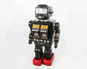 Vintage Rotate-O-Matic Super Astronaut Tin Toy Robot with Box. Made in Japan. Circa 1960's.