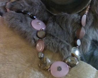 Rose quartz and silver toned necklace