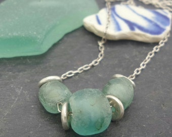 Sea glass silver necklace. Sterling silver rustic recycled green aqua glass bead necklace