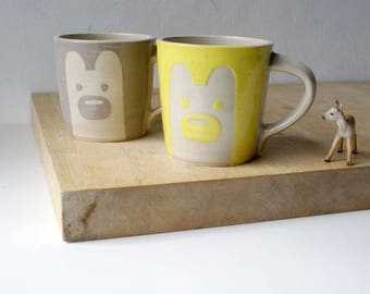 SECONDS SALE - Two tall yellow and grey bear mugs glazed in simply clay