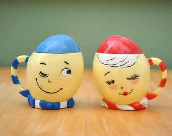 Vintage 1950's egg salt and pepper shakers, anthropomorphic Mr. & Mrs. Egg made by F F Mold Co