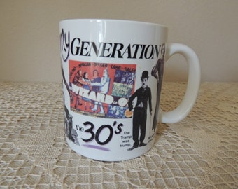 My Generation the 30's Pictorial Cup. 1994 White Ceramic Mug.  30's Coffee Mug. Harlow, Gable and The Wizard of Oz Mug. The Tramp Was Trump.