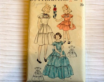 Vintage 1940's Girl's Day & Party Dress sewing pattern.   Butterick. Girl's Size 8.   No. 4885.