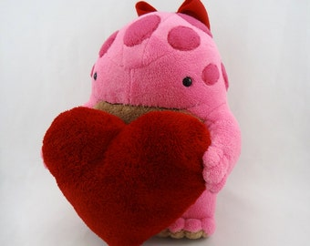 Pink and tan quaggan with red heart plushie stuffed toy
