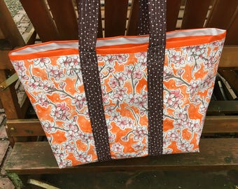 Large cherry blossom reversible  floral oilcloth tote bag on orange
