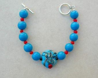 """Blue Funny Face Bracelet, Handcrafted Lampwork Glass Focal Bead, Blue Ceramic and Red """"White Heart"""" Glass Beads, by SandraDesigns"""