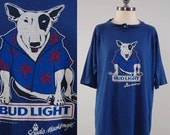 Reserved Vintage 80s SPUDS Mackenzie Bud Light beer t shirt / Soft thin and worn in navy blue tee / Jersey style t shirt