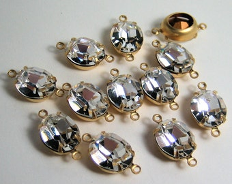 12 - 12x10 Swarovski Machine Cut Crystal Ovals in Brass Prong 2 Ring Settings