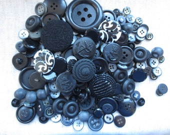 Vintage black assorted size classic sew hole and shank plastic buttons. Lot of 210 buttons.