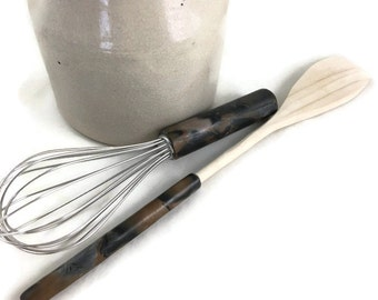 Small whisk and wooden spoon set with unique handles