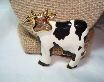 Holstein 1980s Enameled Cow Pin with Red Jeweled Eyes.