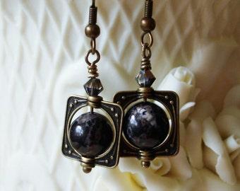 Black Howlite Beads in Ring of Saturn Settings   C 10-1