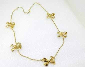 Gold  Bows Delicate Necklace Ribbons in Golden loops.