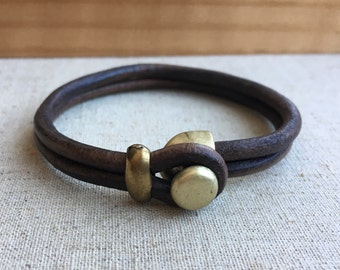 LEATHER CUFF bracelet. dark BROWN distressed leather with antique brass button clasp.