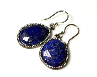 LP 1382 Oval ,Faceted Lapis Gemstone In A Black Gold Bezel With Diamond White CZ Earrings