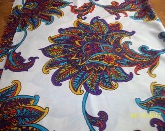 Polyester fabric in purples, blues, golds, and reds