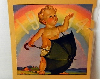 vintage print 1934 baby rainbow and umbrella advertising collage altered art collectible