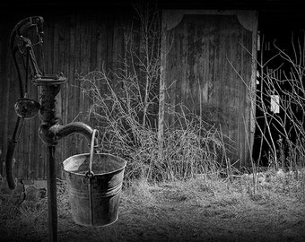 Metal Bucket and Old Water Pump by an Old Weathered Wooden Barn in Rural West Michigan No.BW251 - A Vintage Fine Art Still Life Photograph