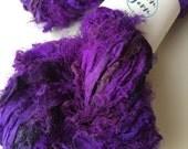 Rebellious sari silk ribbon with an eyelash edge. 50g. Ethical yarn, electric plum, knitting yarn, crochet yarn, fiber art, jewelry making.