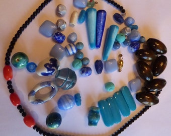 A Little Bag Of Beads . Mostly Glass and Wood . A Few Coral Beads too
