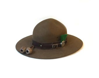 Vintage Australian scoutmaster hat with green plume badge and gumnuts, scout leader hat